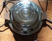Retro Art Deco Style Waffle Maker with Chrome Covered Metal finish case in working condition with well developed patina