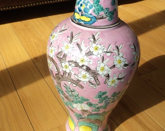 Vintage Asian Bell Jar Vase with wonderful hand painted floral display against a bright pink background setting in Good Vintage Condition