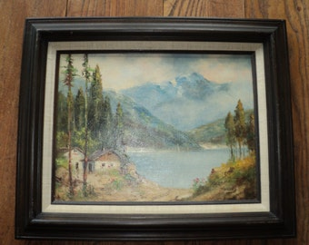 Vintage Original Oil Painting on Canvas Board of A Chalet on the Lake surrounded by Mountains, Signed by The Artist in Very Good Condition