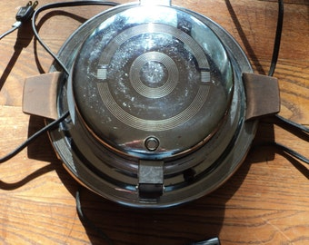 Retro Art Deco Style Waffle Maker with Chrome Covered Metal finish case in working condition which shows signs of use