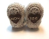 Gender neutral pregnancy reveal photography prop with due date.  Made to order.  Crochet baby booties with hearts.