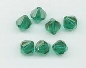 Ten sparkling vintage Swarovski crystals - Art 5304 - 10 mm - emerald