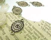 8 small oval vintage  style pressed flower design connector links doubel  sided image size 19 mm x 11 mm