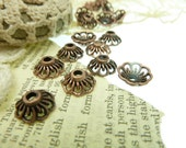 30 scalloped sided antique copper bead caps. Tibetan style .Size  11 mm x 5 mm