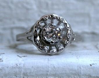 Vintage 14K White Gold Halo Diamond Engagement Ring - 0.87ct.