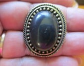 Vintage Jewelry Ladie's smooth  black stone oval Ring adjustable antiqued brass toned finish  no markings