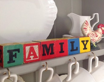 """Vintage wooden toy blocks """"FAMILY"""" red, blue, yellow and green"""