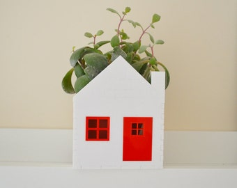 Red and white little house planter ideal for succulents
