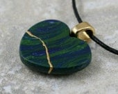 Small broken heart pendant in swirled blue and green polymer clay with gold kintsugi (kintsukuroi) style repair - OOAK