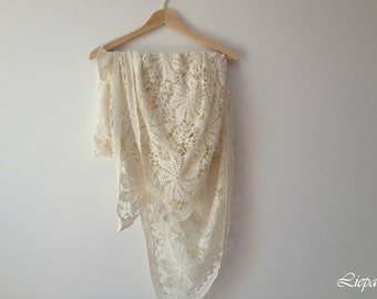 Hand crocheted light cream tablecloth