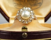 An excellent Victorian natural Oriental pearl and 1.50 Ct old diamond ring