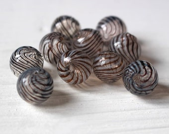 Hand blown hollow glass beads, transparent swirl