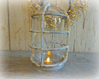 vintage industrial cage light with glass dome