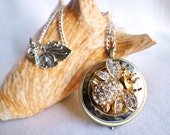 Music box locket, round bronze locket with music box inside, with stacked hammered rings and a rhinestone bumble bee