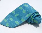 Vintage 1970s Wide Light Blue Polyester Tie with Green Leaves