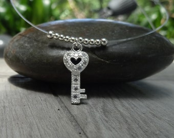 Tiny key floater necklace. Sterling silver.