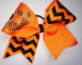 """Cheer Bows for sale; 3"""", 3 inch cheer bow with black glitter chevron and rhinestone black and white paw pawprint on orange grosgrain ribbon"""