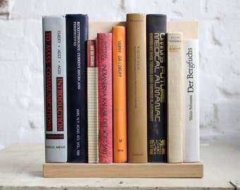 """Wall Decoration from Upcycled Book Spines """"Mass Communication George"""""""