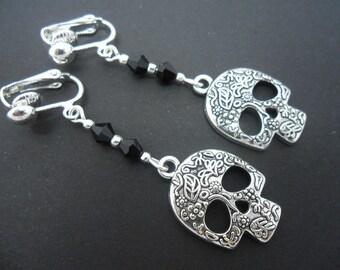 A pair of tibetan silver skull & black crystal bead dangly clip on  earrings.