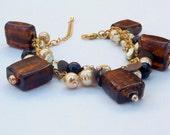 bronze glass and gold cream charm bracelet