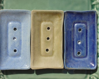 Beautiful, light weight ceramic soap dishes. Perfect match for our soaps. Great gift idea or spoil yourself.  Dark blue or beige in colour.