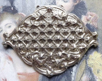 Half buckle/clasp to use as a trim, Antique, pressed metal with a hint of Roccoco, c1890.