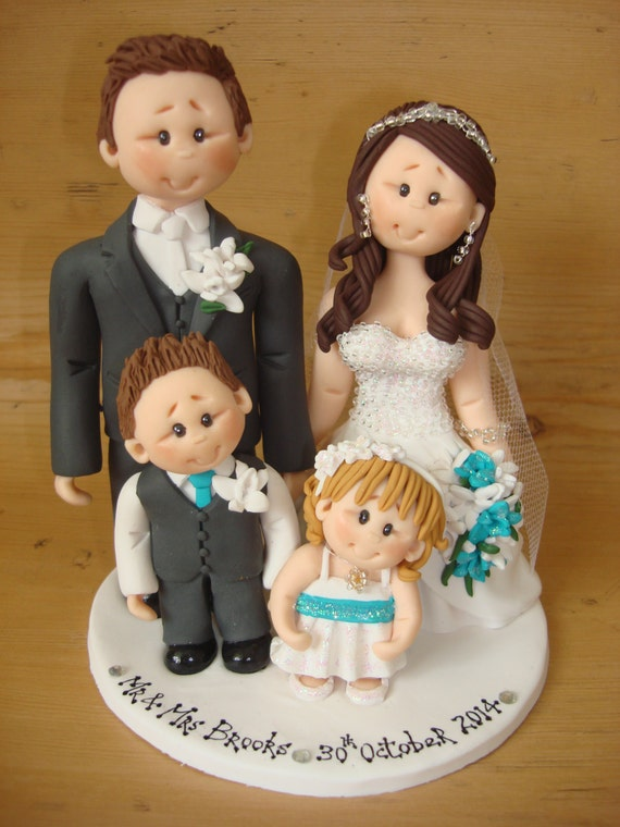 wedding cake toppers including child items similar to and groom with wedding cake 26503