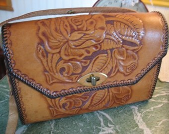 Tooled leather purse. Brown leather bag.