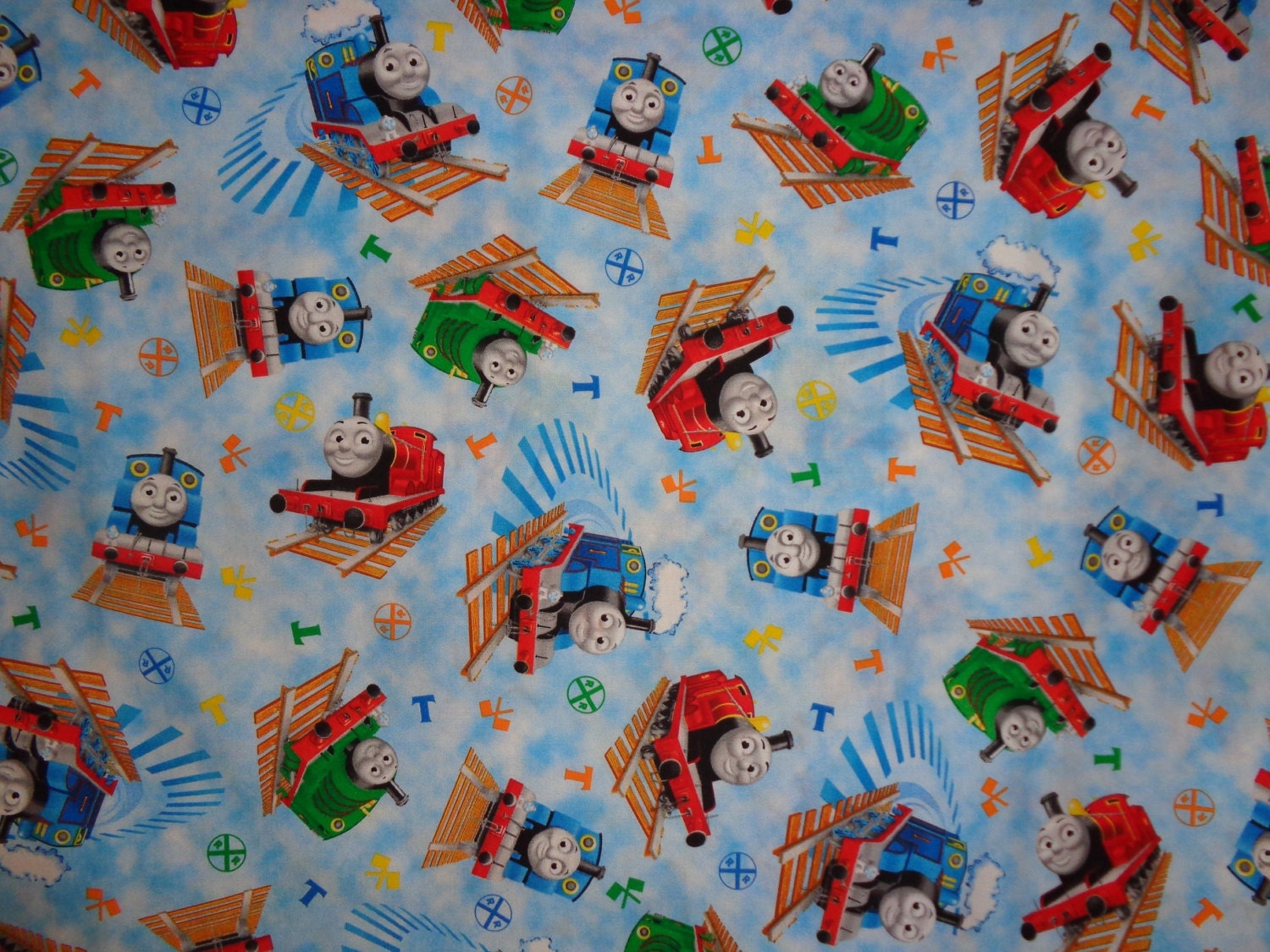 Thomas train blue with multicolor trains cotton fabric by the for Train fabric by the yard