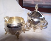Silver vintage footed cream and sugar bowls with Victorian scrolling