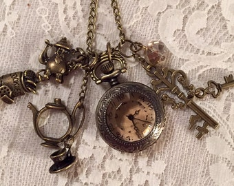 Small Pocket Watch Necklace With Amber Glass Face.  Antique Bronze Tone.