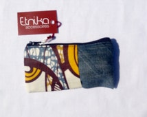 Faded denim wallet case in africant print.