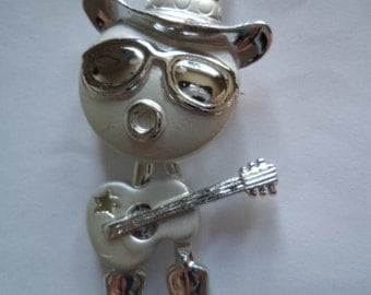 Vintage Unsigned Silver/Matt Guitar Playing Cowboy Brooch/Pin   (Body Swings)