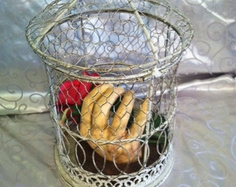Plaster Casted Hand with Rose in Wire Bird Cage
