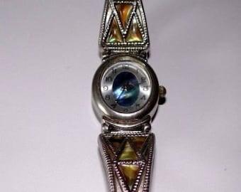 Blue oval face watch, quartz watch, bluish green face,  flexible, 1980s, needs battery,  LA Express