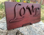 The word Love in English Art Work in Purple Heart Exotic Wood. A Unique and Original Design with removable letters. Pin it if You Like it!