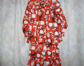 Size 8 Girls Pajamas with dogs on orange background