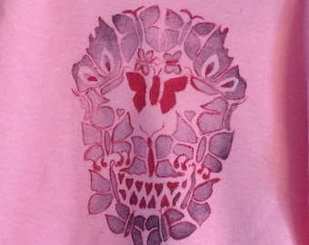 Girls pastel pink T Shirt with unique butterfly/skull print designed by MokoTogs