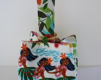 My Hula Girls Trio Bag with a white background and a bright pink dupioni silk lining; all cinched up by a trio of bamboo rings - Mahalo!