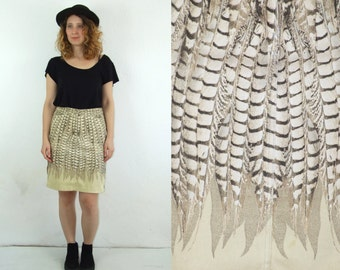 90's vintage women's brown high waisted  denim zippered skirt with wing print