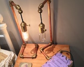 Copper pipe steam punk lamp with brass fittings completed with an edison bulb