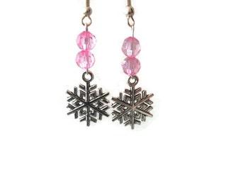 Pink beaded snowflake dangle earrings
