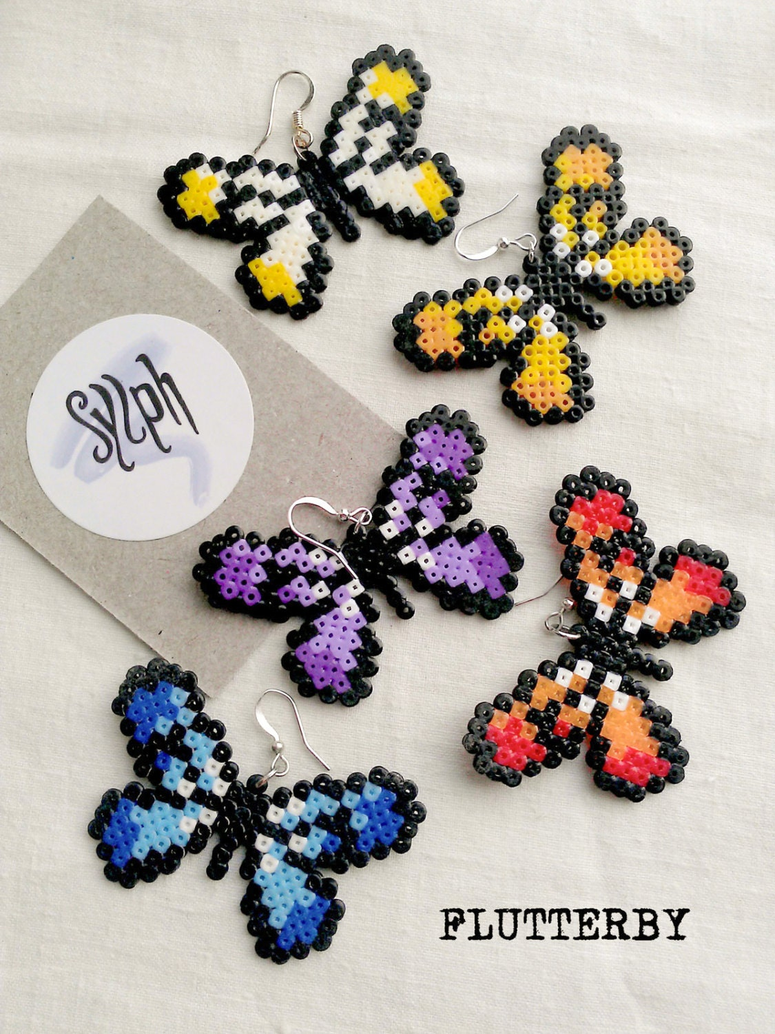 shades of blue pixelated butterfly earrings flutterby made of hama mini perler beads in 8bit. Black Bedroom Furniture Sets. Home Design Ideas