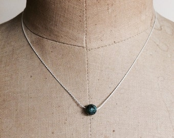 Blue speckled bead on sterling silver chain by Apricity Jewelry