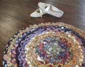 Multicolored Braided Area Rug With Gold and Purple Accents and Beige Backing