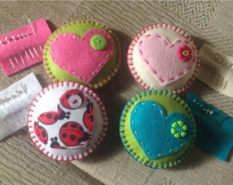 Pin cushion with needle and pins (one only)