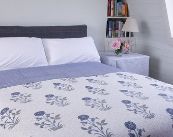 REVERSIBLE QUILT BEDSPREAD - Blue Flowers. Reverse grey/blue background with small off white flower pattern.
