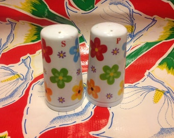 Vintage plastic colorfully flowered salt and pepper shakers
