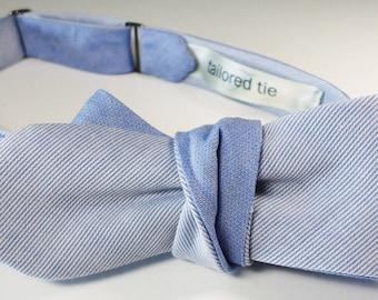 Sky blue English Pima cotton striped piqué men's bow tie... over a 'pebbly weave' miniature check reverse blade. Slim, adjustable self-tie.