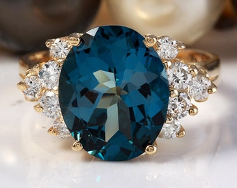 5.50 CTW Natural London Blue Topaz and Diamonds in 14K Yellow Gold Ring